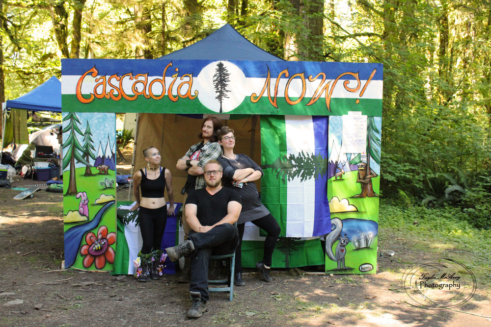 The CascadiaNow! squad posed in front of our booth painted by Seattle artist Ryan Henry Ward.