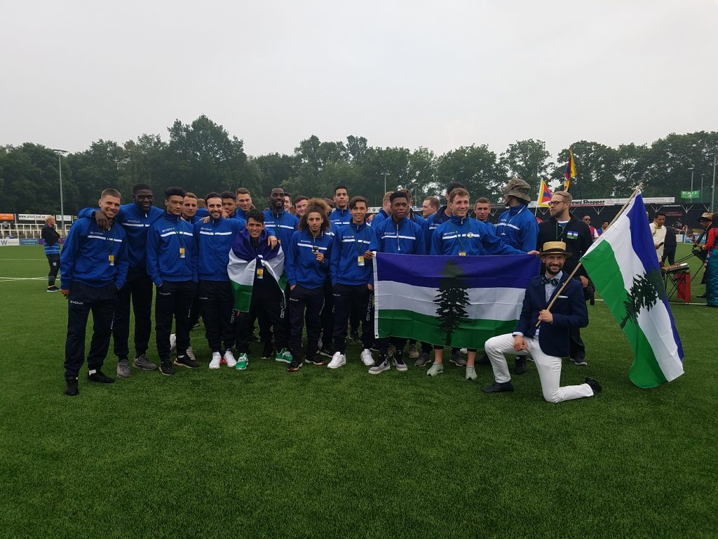 Team Cascadia huddled together after marching in the opening ceremonies of the CONIFA World Football Cup 2018. Absent are the Team Cascadia coaches.