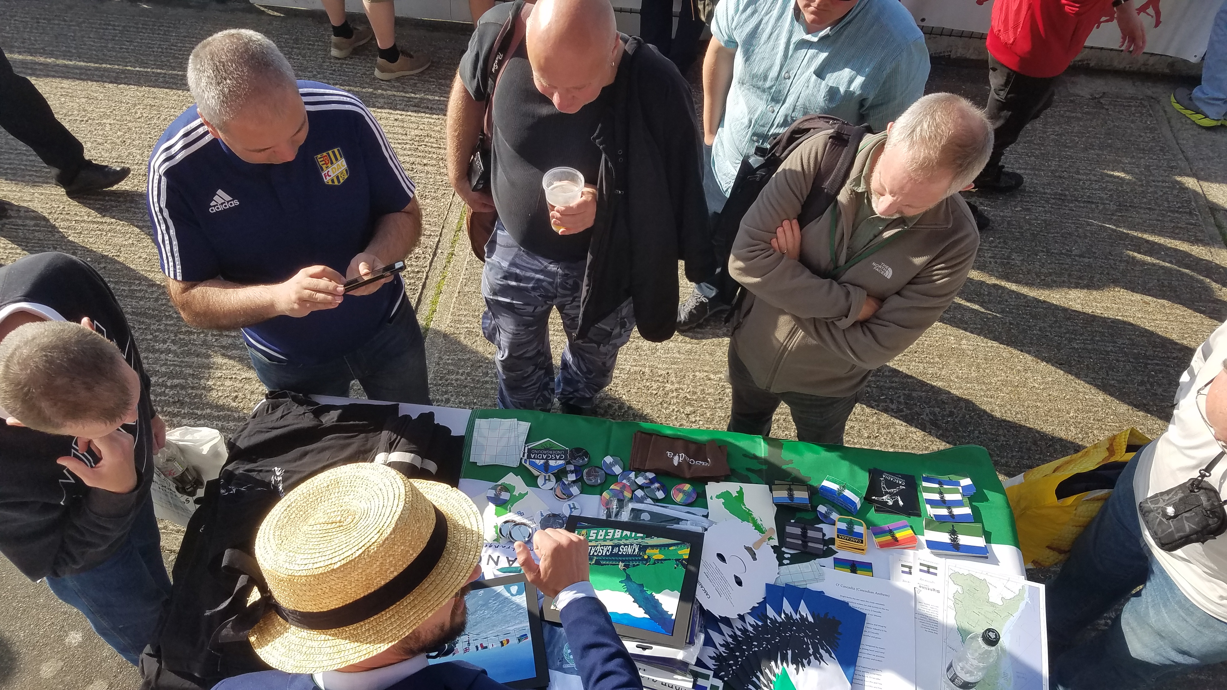 Trevor Owen mans the Cascadia information table at a match during the CONIFA WFC2018